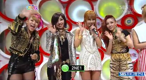 Bom in a modified Versace Spring/Summer 2012 dress