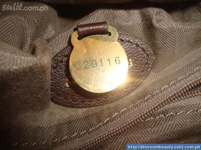 Mulberry fake serial number 329116