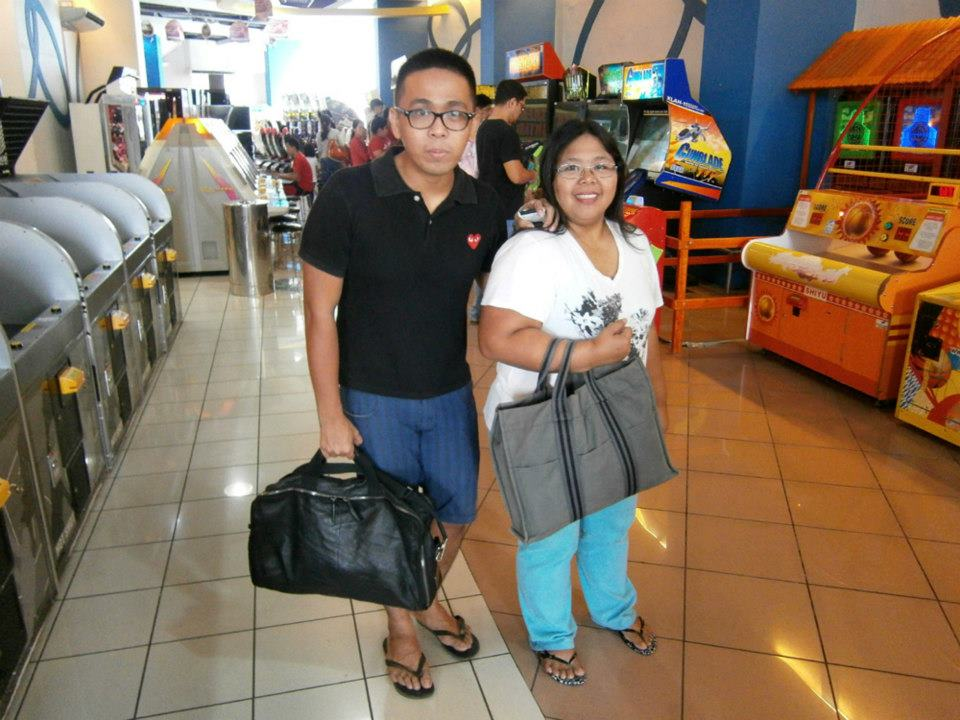 """My sister (using my new-to-me Hermès Fourre Tout bag, even before me!) and I (in black Play by Comme des Garçons polo shirt, blue Penshoppe shorts and Givenchy luggage duffle bag) - Eastwood CIty Mall, Quezon City, Philippines"""""""