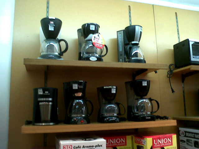A shelf of coffee makers from SM Makati