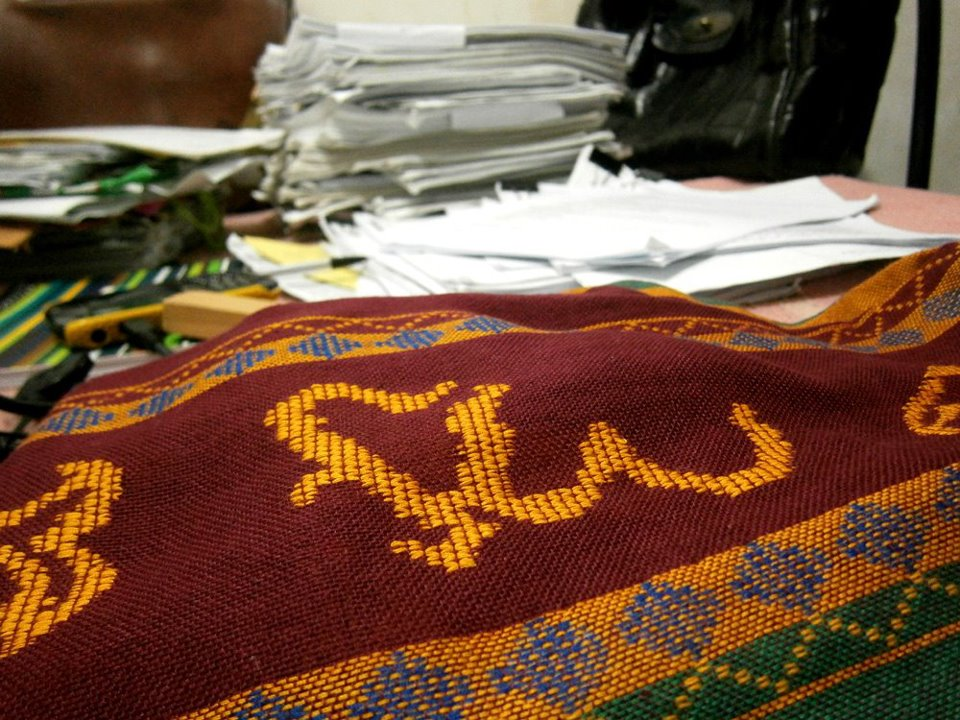 I'm ready to wear my Sablay again (pictured here next to a pile of school readings for compre exams last July) - UP Diliman