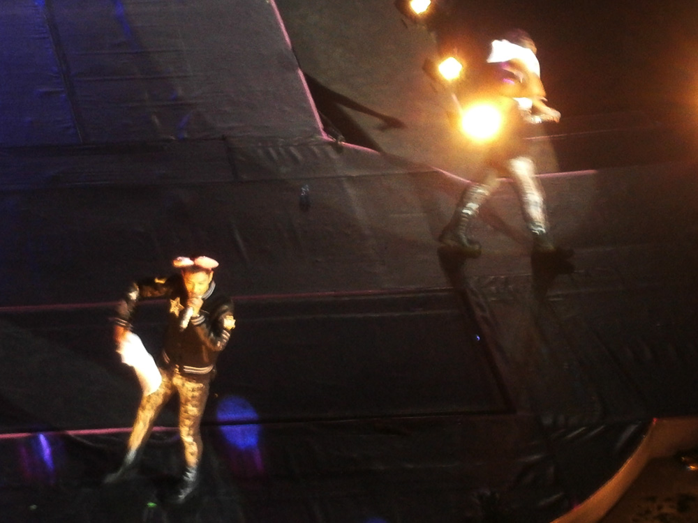 T.O.P. with the very girly mouse ears and Daesung walking out of the frame LOL - Big Bang Alive Tour 2012 in Manila
