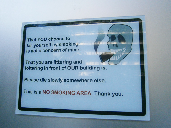 he peculiar 'No Smoking' sign in SMART Building along Ayala Avenue - Makati City, Philippines