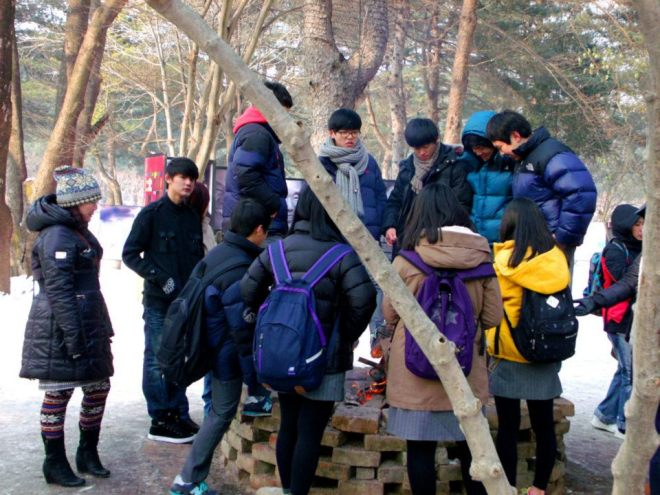 A bunch of school chlidren gathered around the fire --- Winter in Seoul December 2012 - Day 3: Nami Island