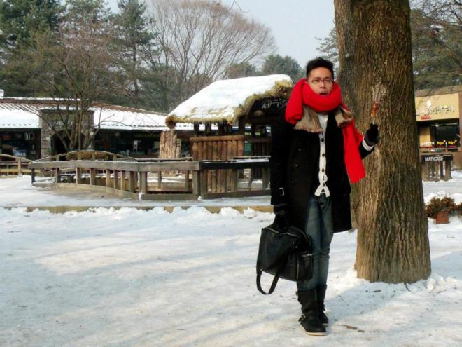 Almost done with the sausage I was eating --- Winter in Seoul December 2012 - Day 3: Nami Island