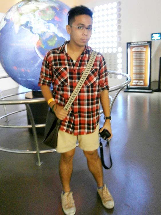 Black Chocoolate red flannel shirt, khaki shorts, salmon pink Jack Purcell sneakers, Burberry leather messenger bag 2