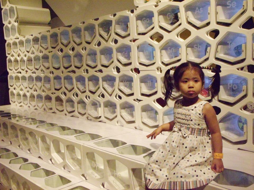 Brie sitting by the giant periodic table - The Mind Museum at Taguig