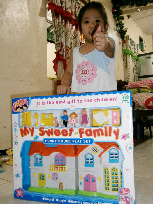 Brie with her doll house