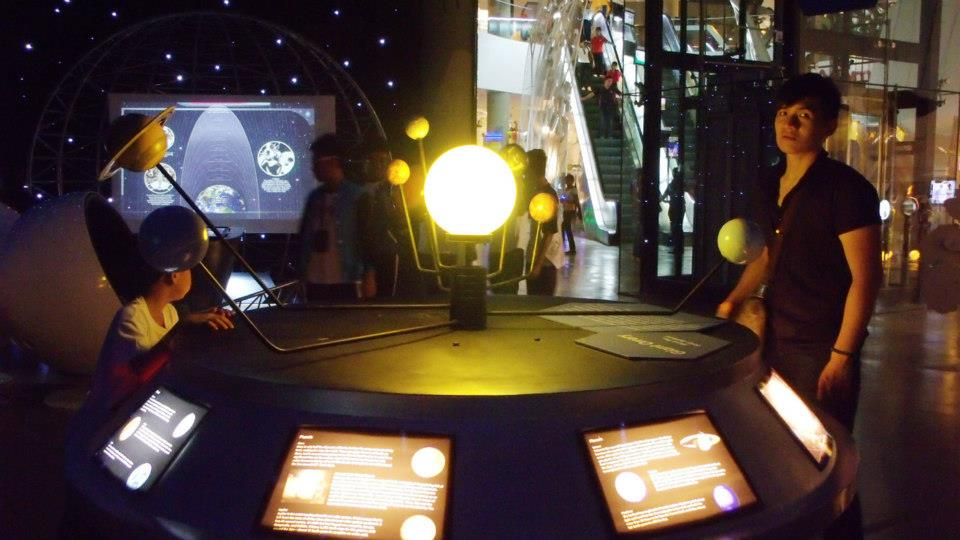 JB and Mon trying out the solar system model - The Mind Museum at Taguig