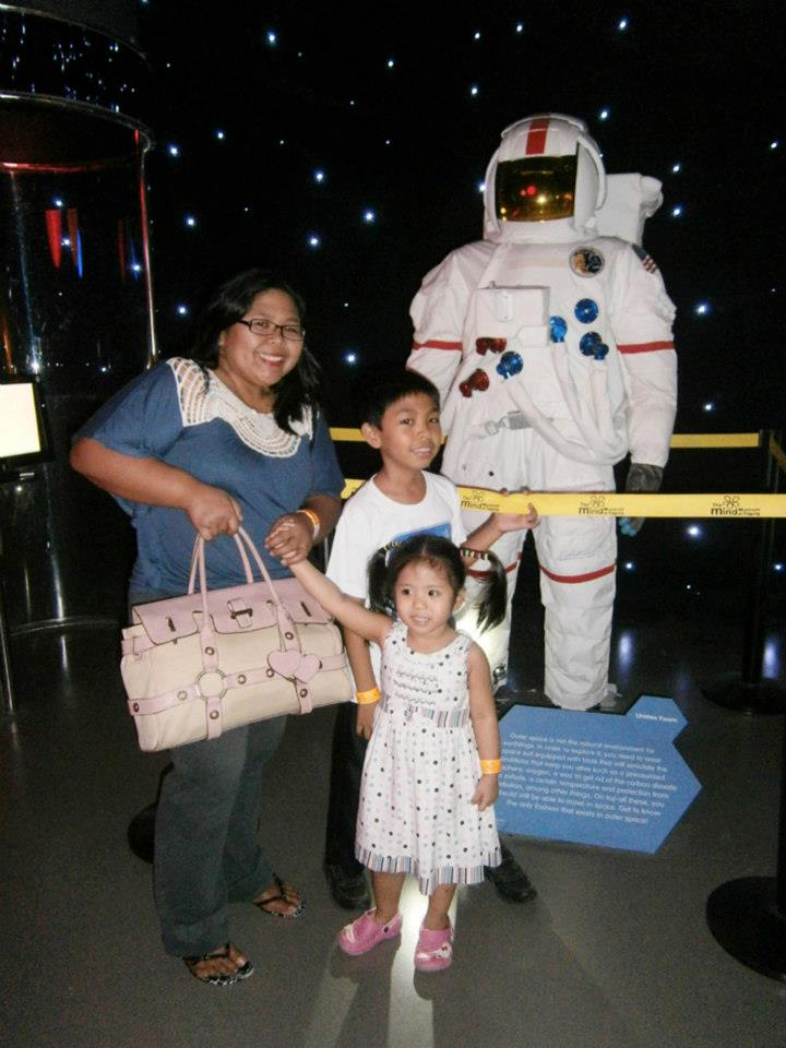 My sister and her kids with this astronaut -  - The Mind Museum at Taguig
