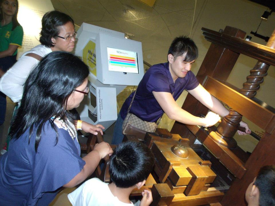 Trying out the printing press  - The Mind Museum at Taguig