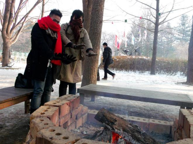Warming ourselves in front of the fire --- Winter in Seoul December 2012 - Day 3: Nami Island