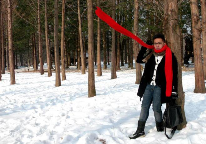 Yet another shot with a group of trees --- Winter in Seoul December 2012 - Day 3: Nami Island red muffler, Two Percent Homme Varsity cardigan, Jil Sander white ribbed longsleeves shirt, black trench coat, Jag jeans, PathFinder boots, and Givenchy luggage duffle bag