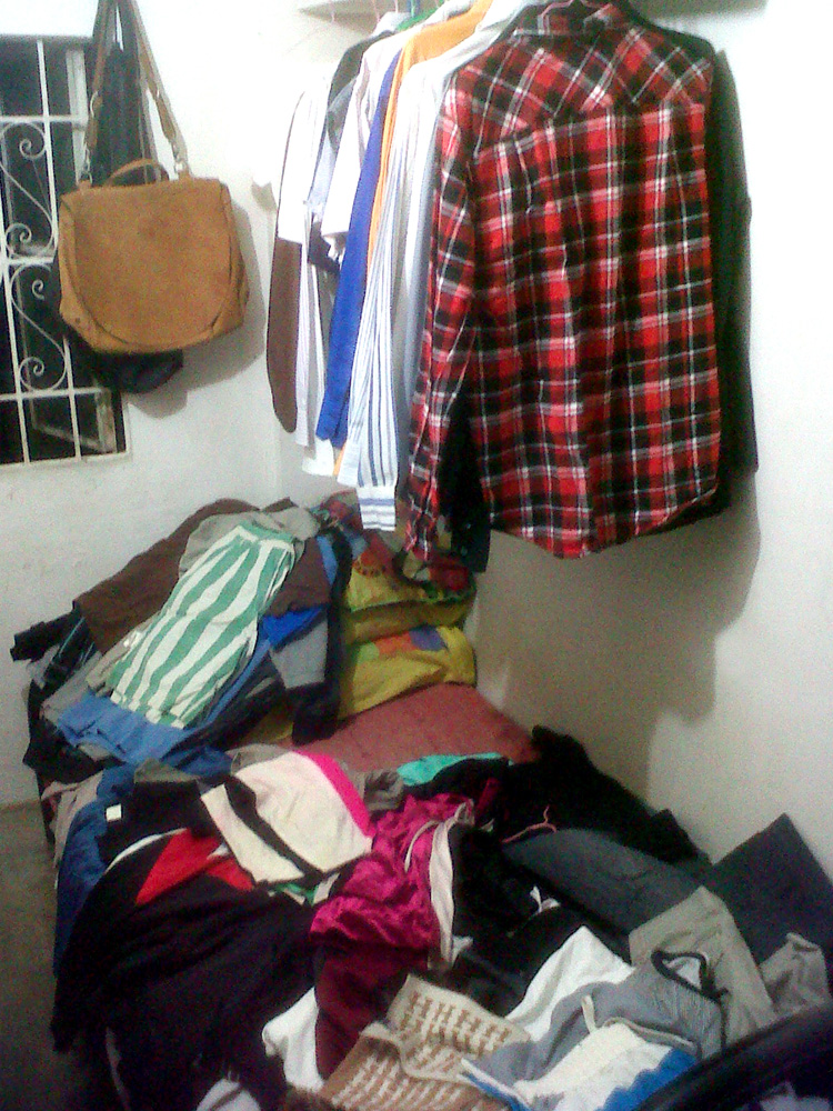 A pile of clothes waiting to be sorted