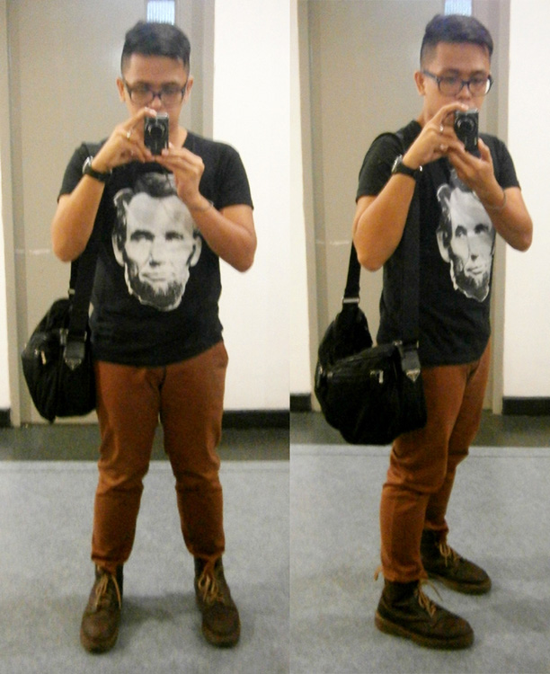 Cross-eyed Abraham Lincoln shirt, brick pants, brown 8-hole Doc Martens and  black Prada nylon and saffiano messenger - Manila, Philippines