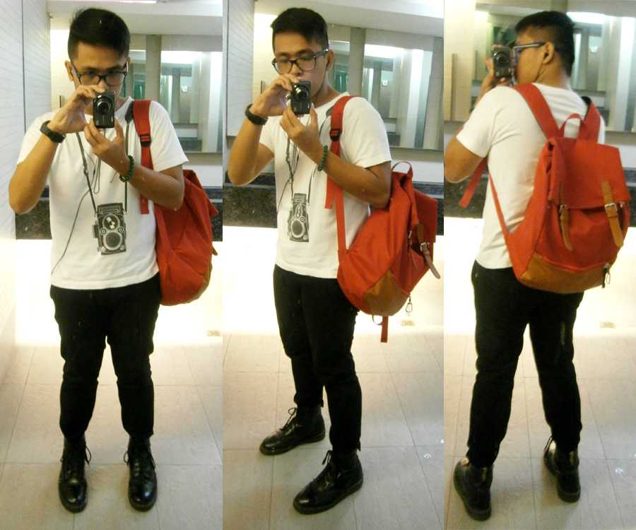 Old-school camera print shirt from Graniph, black skinny pants, black 8-hole Doc Martens and red canvas backpack