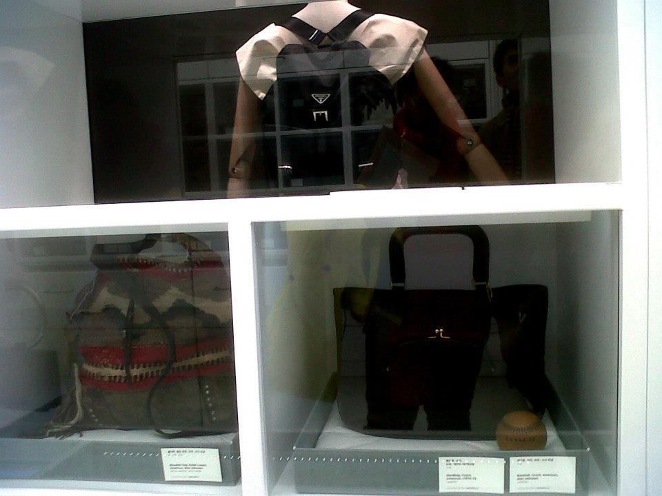 Prada nylon backpack (1980-89), Ralph Lauren shoulder bag, Coach handbag (1970-79) and Coach baseball - Simone Handbag Museum, Gangnam-gu, Seoul, South Korea