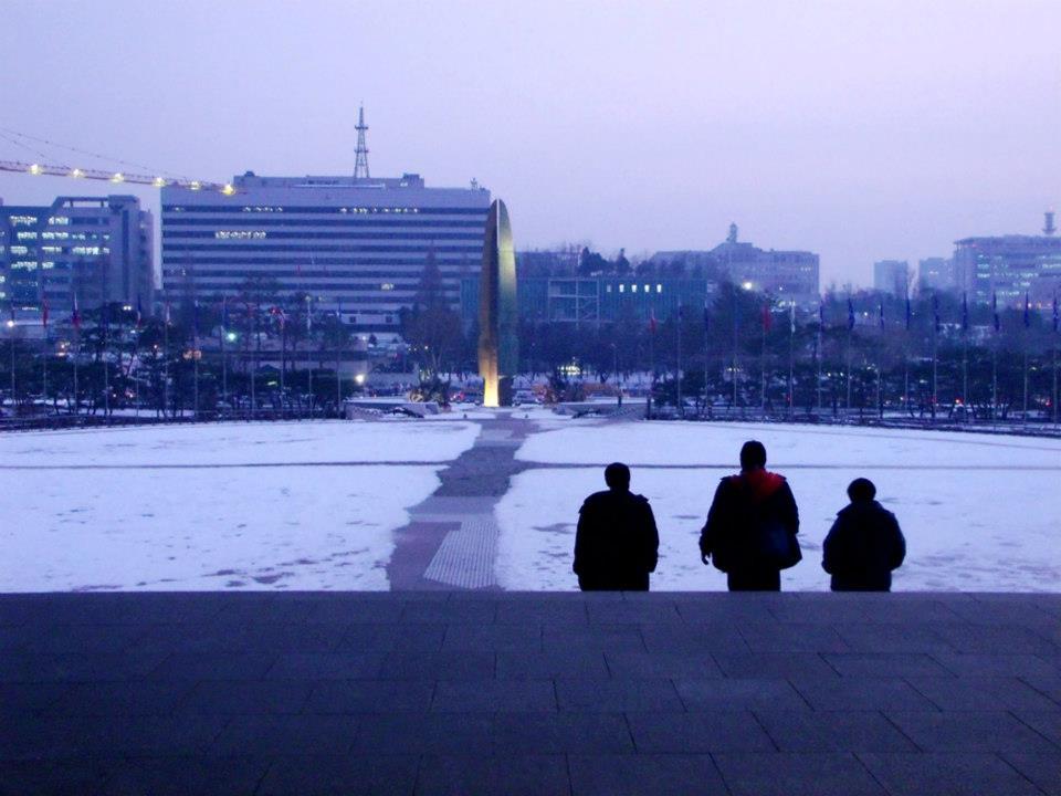 Three people leaving the Main Building of War Memorial of Korea