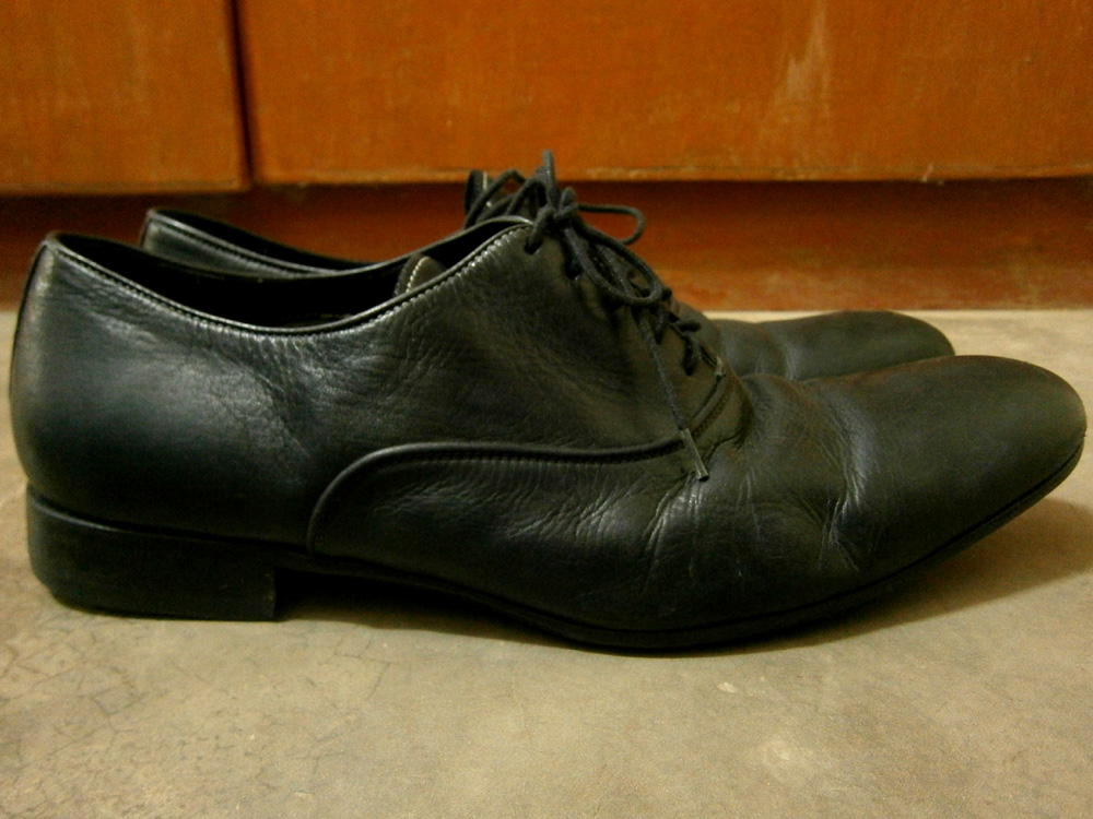 A pair of black Paul Smith Dip Dyed Cervantes Oxford Shoes
