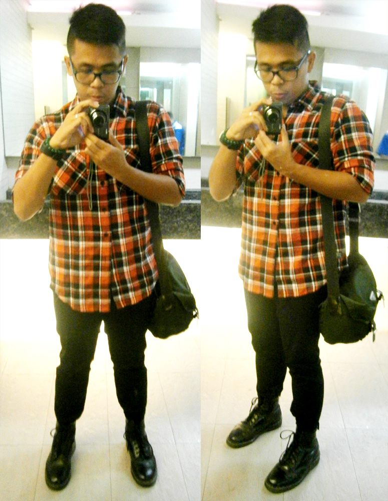 Black Chocoolate red flannel shirt, black pants, black 8-hole Doc Martens and  olive green Prada tessuto messenger sling