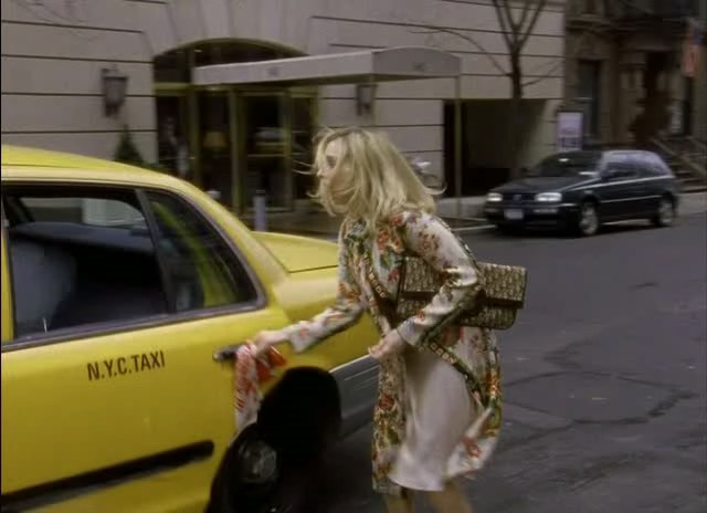 Carrie Bradshaw hailing a cab in New York city on her way to the Stock Exchange, carrying a vintage Christian Dior monogram clutch in Season 6 Episode 1 (To Market, To Market)