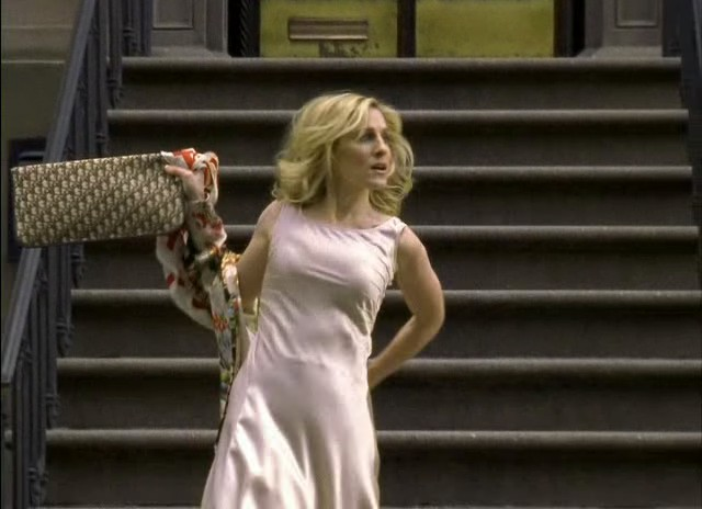 Carrie Bradshaw late for the Stock Exchange, carrying a vintage Christian Dior monogram clutch in Season 6 Episode 1 (To Market, To Market)