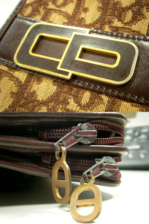 Details of the vintage Christian Dior monogram clutch - enamel 'CD' logo and ECLAIR zippers with goldtone 'CD' zipper pulls