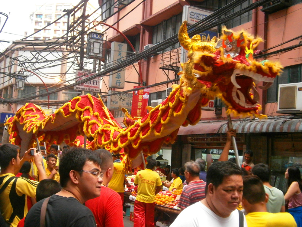 Dragon dance in the streets of Binondo - Chinese New Year 2013