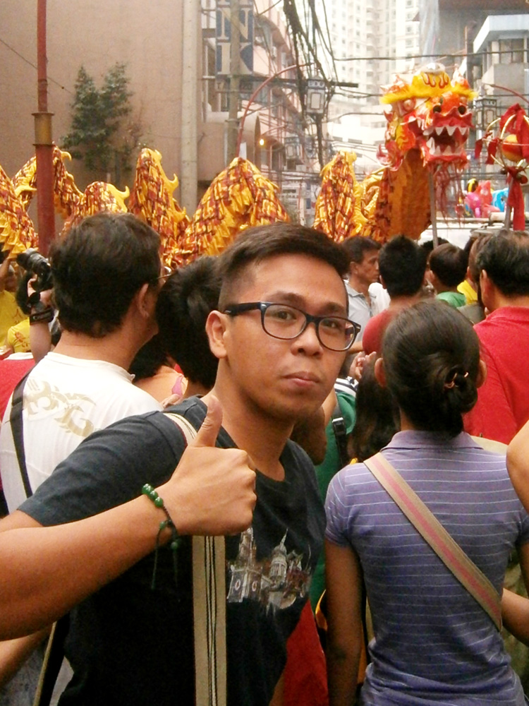Enjoying the dragon dance in the streets of Binondo - Chinese New Year 2013