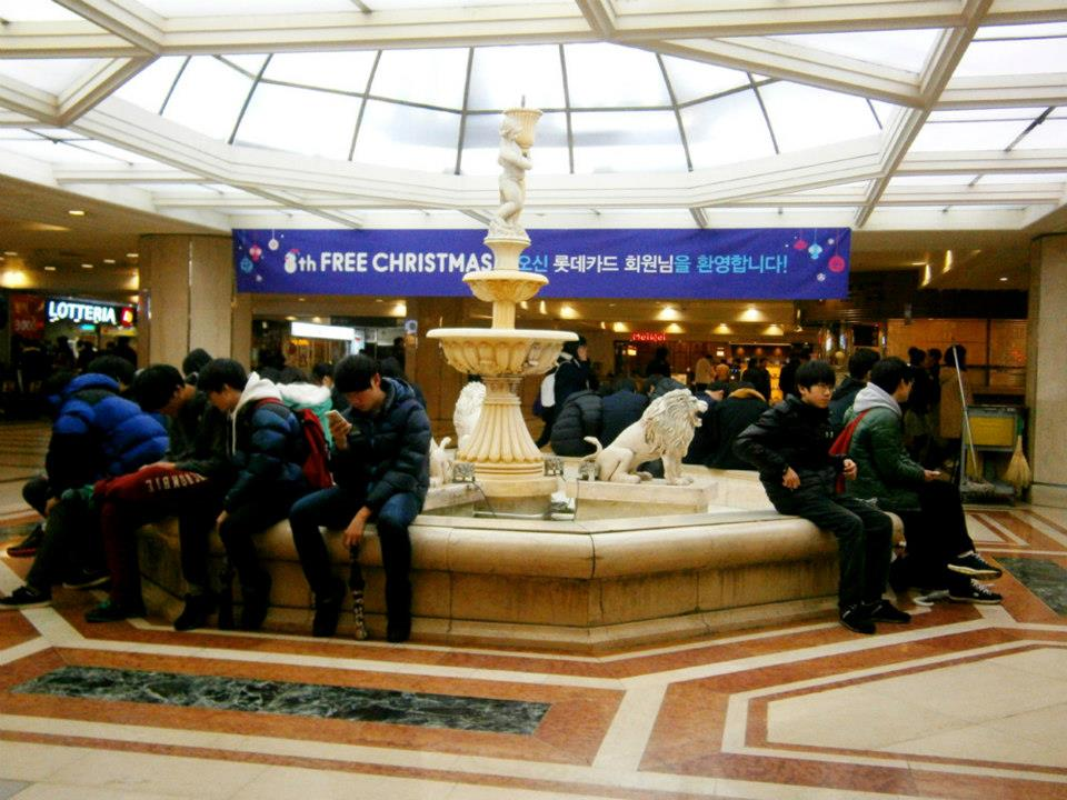 Fountain with people sitting around it - Lotte World, Seoul, South Korea