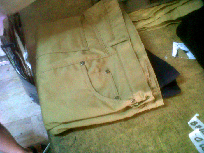 Getting the pants from the tailor