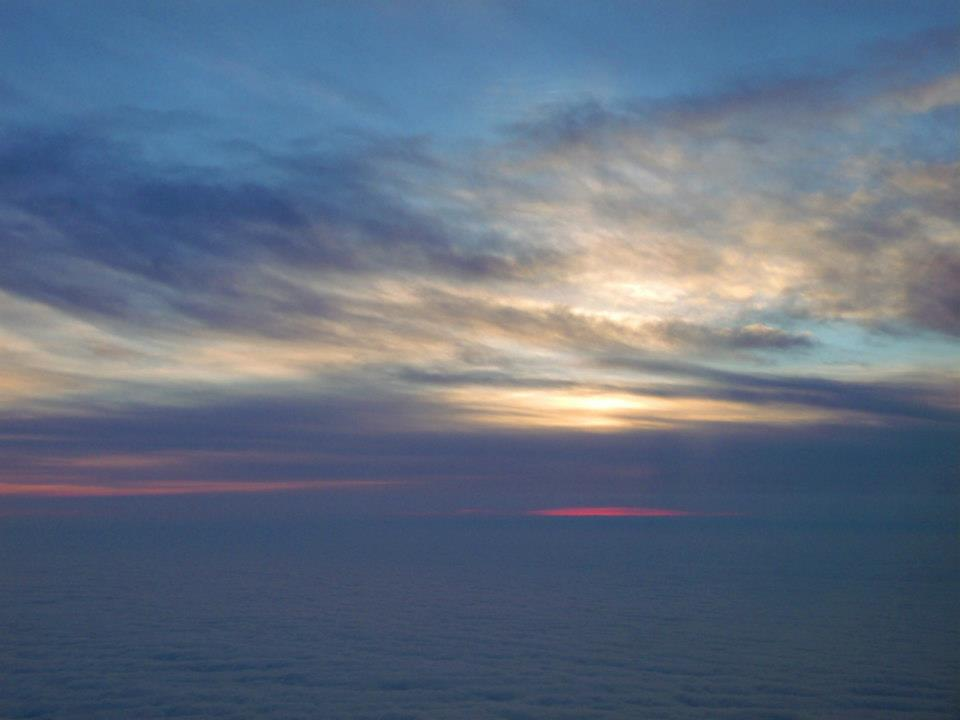 Heart-warming sunrise seen above the clouds