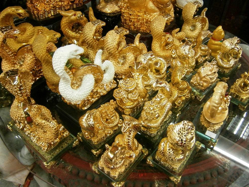 Lots of golden snake figurines -  Binondo, Chinese New Year 2013