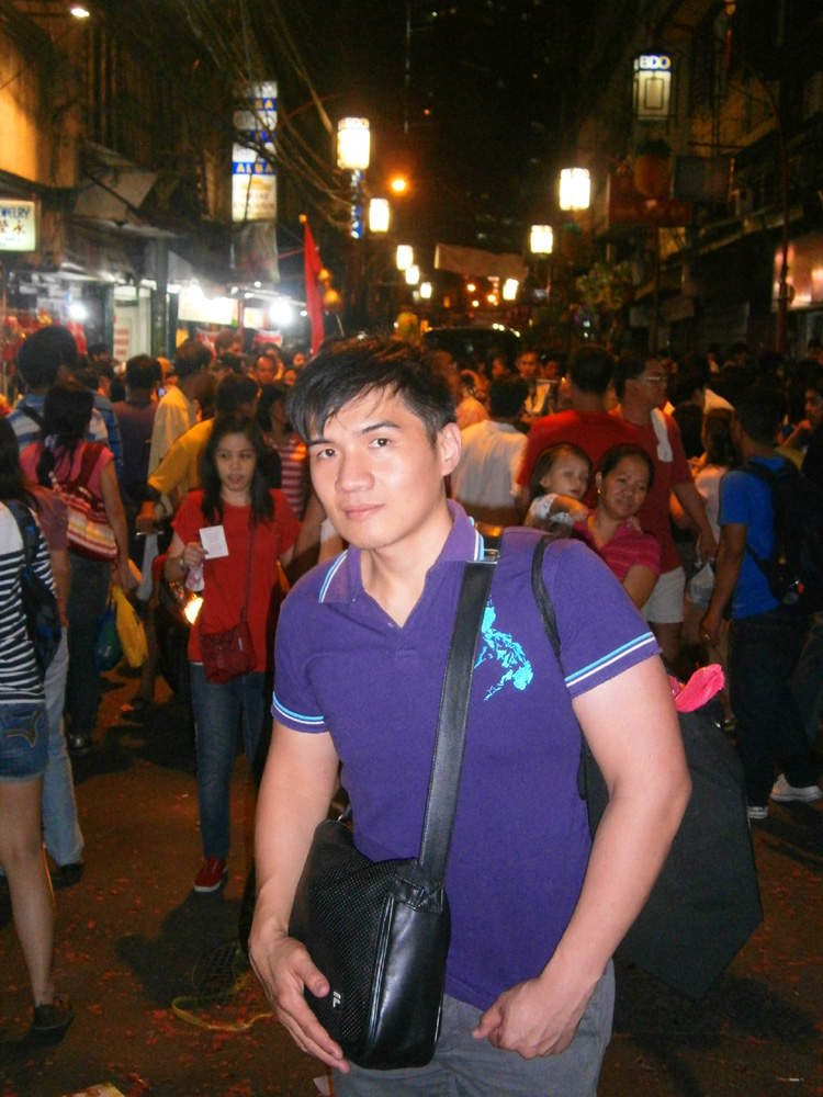Mon and the crowded street of Binondo at night  -  Chinese New Year 2013