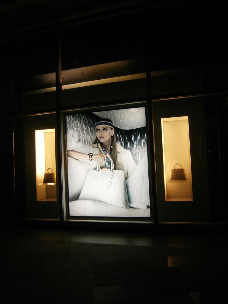 Sasha Pivovarova for Resort 2013 on the display window of Prada Greenbelt 3