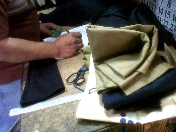 The tailor, Mang Joel, getting the measurement of my other pair of black pants