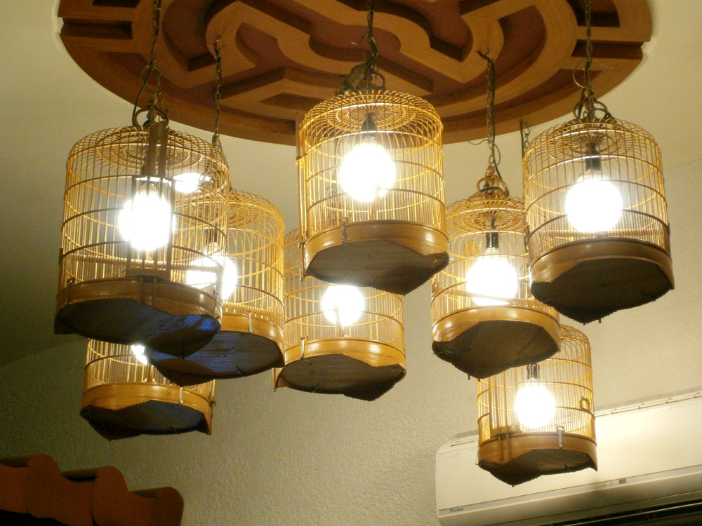 Bird cage lamps hanging from the ceiling