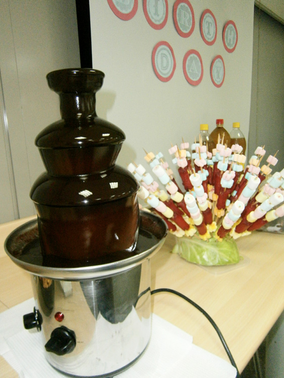 Chocolate fountain and hotdogs on a stick