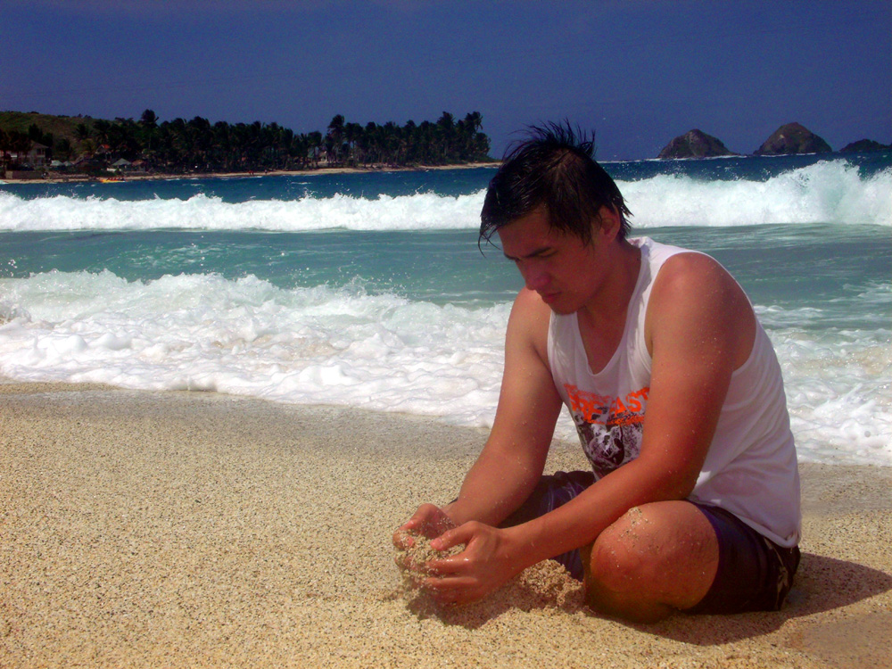 Playing with the white sand - Pagudpud Beach, Ilocos Norte