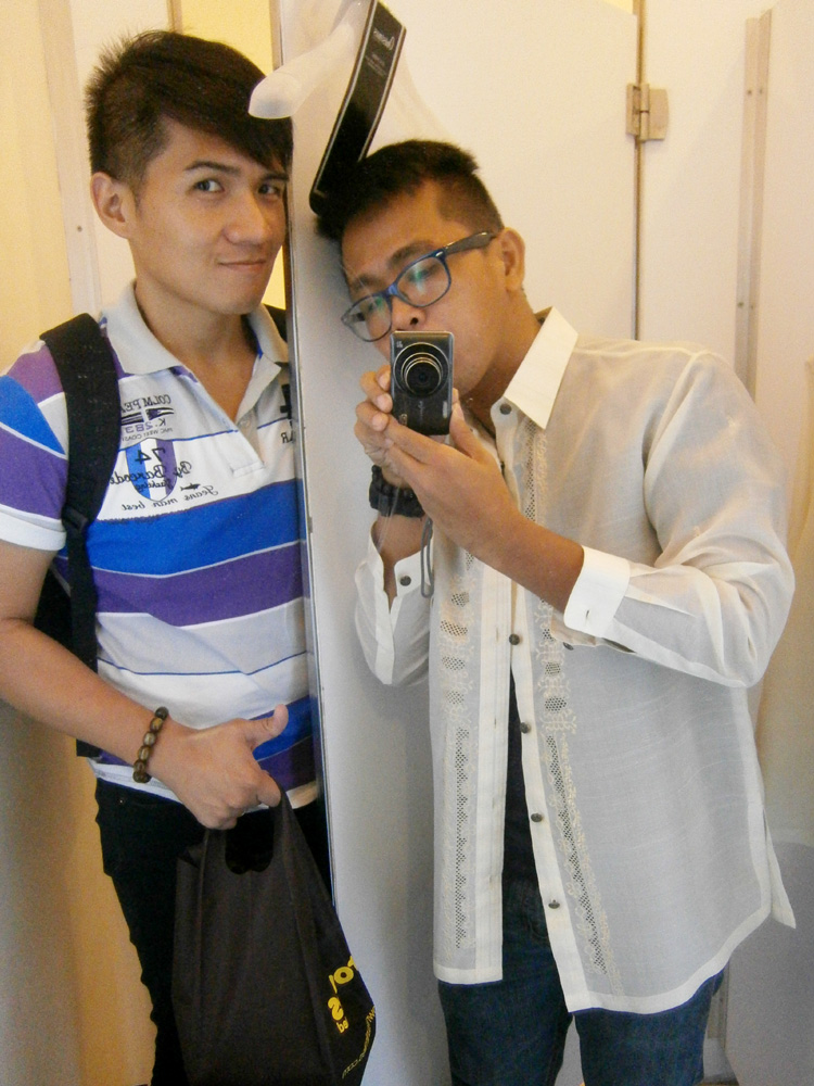Trying on a couple of barong tagalog for the graduation