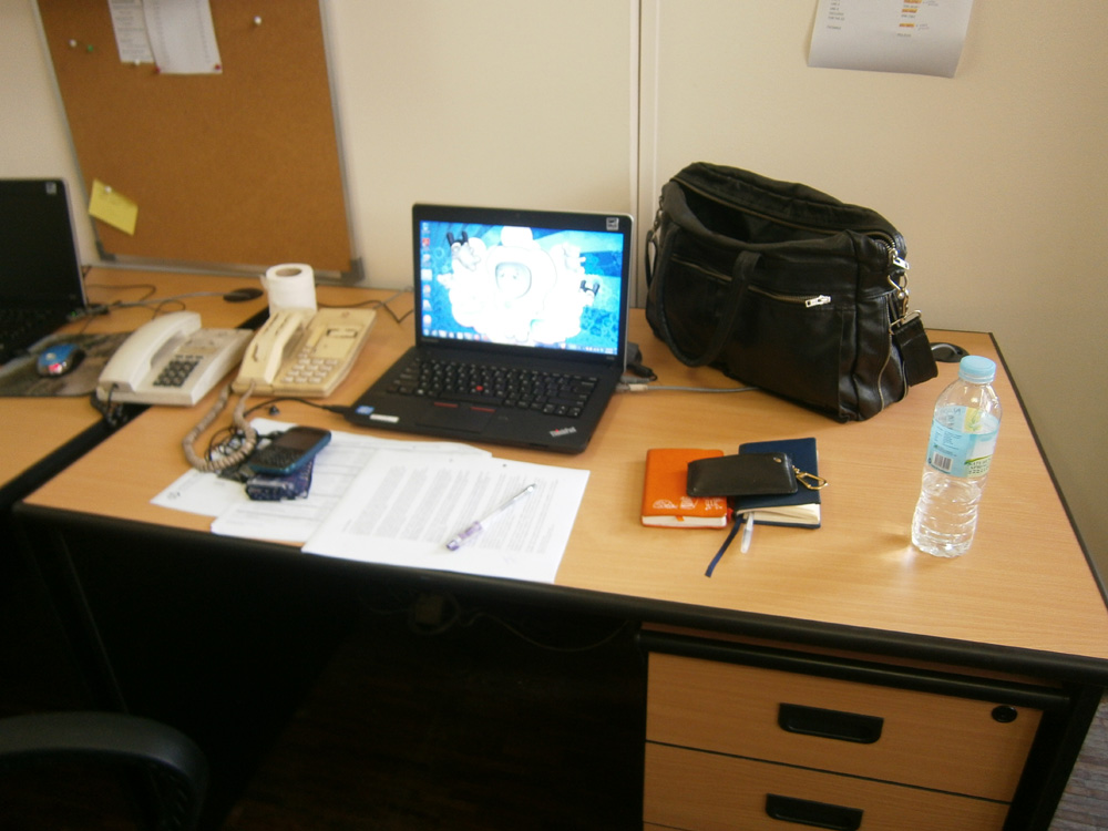 My very bare work station --- a far cry from my busy desk in my other work
