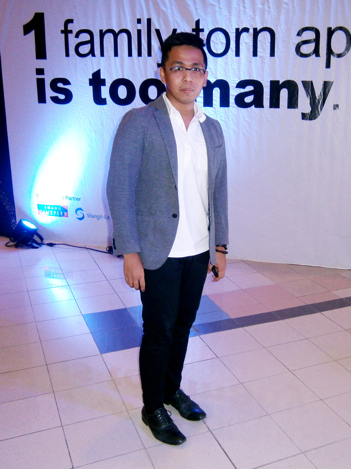 Solo picture by the tarp - Gray Uniqlo Two-Button Blazer, black skinny pants and black Paul Smith Cervantes shoes