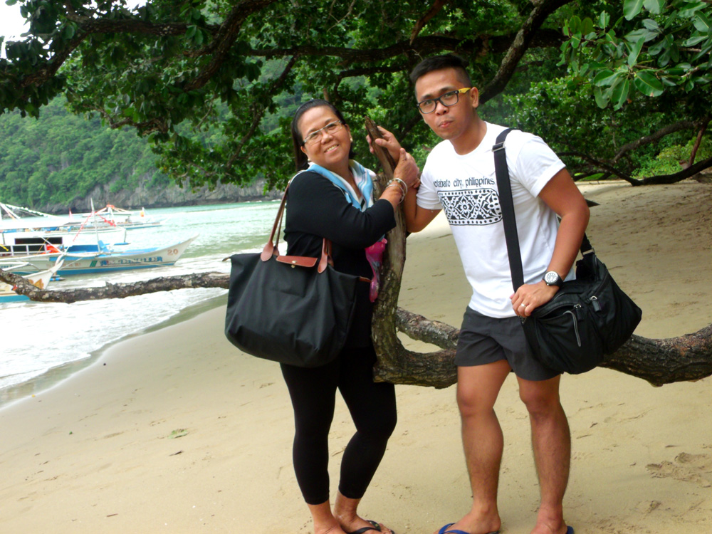 Photo with Mama, while waiting for the boat to pick us up again