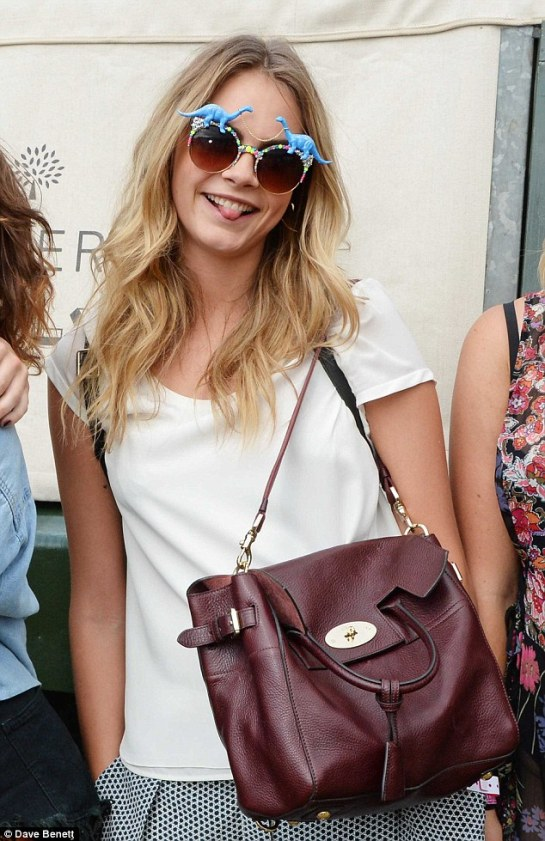 Cara Delevingne with her oxblood Mulberry small Bayswater in Wilderness Festival