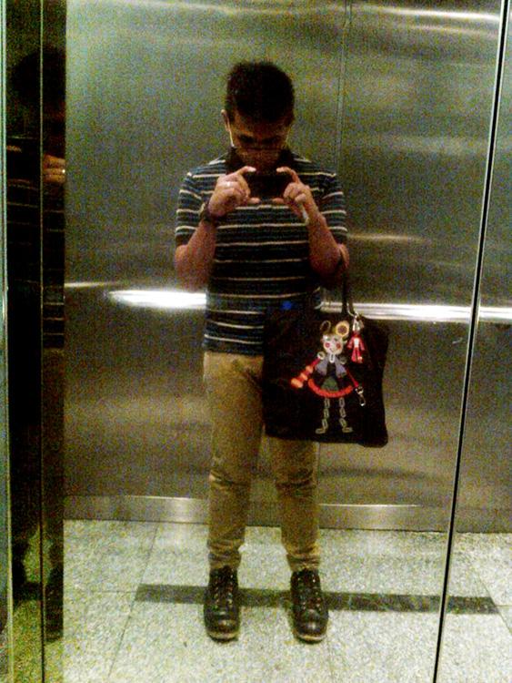 Elevator ride - Uniqlo stripes polo shirt, skinny khaki pants, Red Wing 2913 boot and Prada Tessuto Robot 6 tote Prada Robot Tote