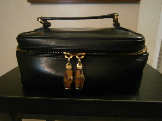 Before restoration of the vintage Gucci bamboo cosmetic leather bag
