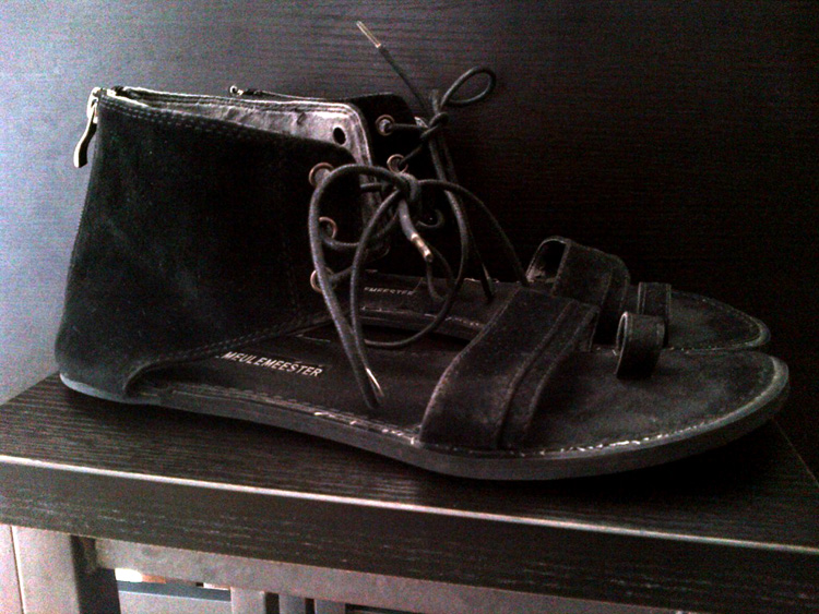 A pair of Ann Demeulemeester suede laceup sandals